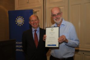 Francis Jacobs, who recently retired from the European Parliament office in Dublin, is presented with Honorary life membership by Ambassador Chillcott.